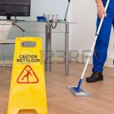35462891-close-up-of-janitor-mopping-with-wet-floor-sign-in-office-4.jpg